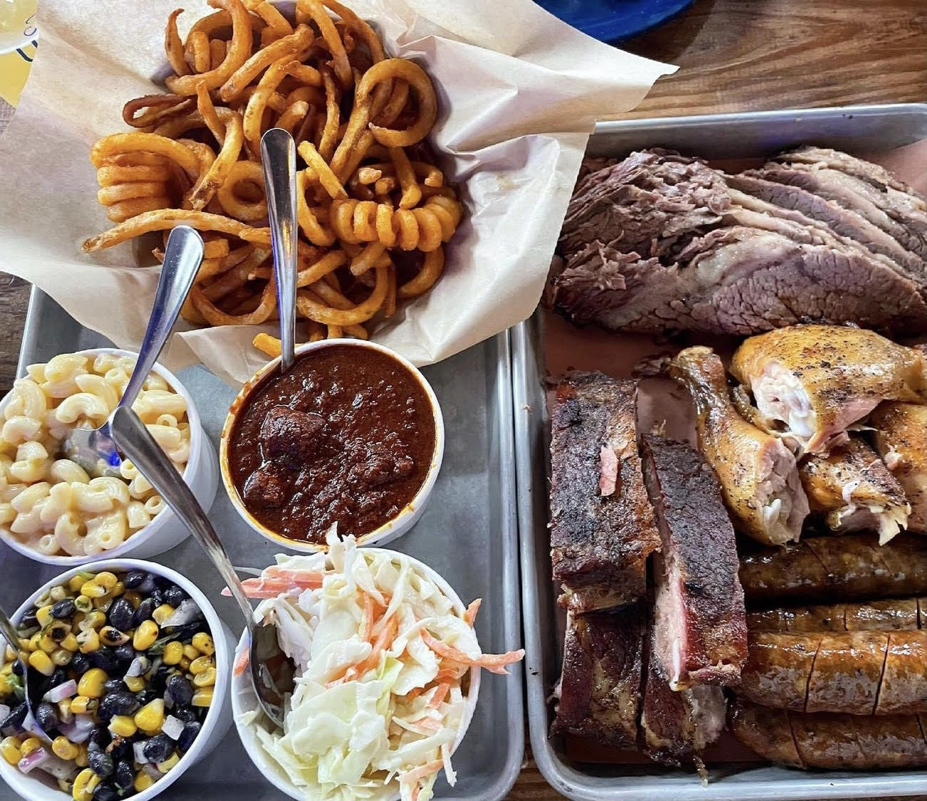 Combo platter with sides and curly fries from House of 'Que in Hoboken, NJ